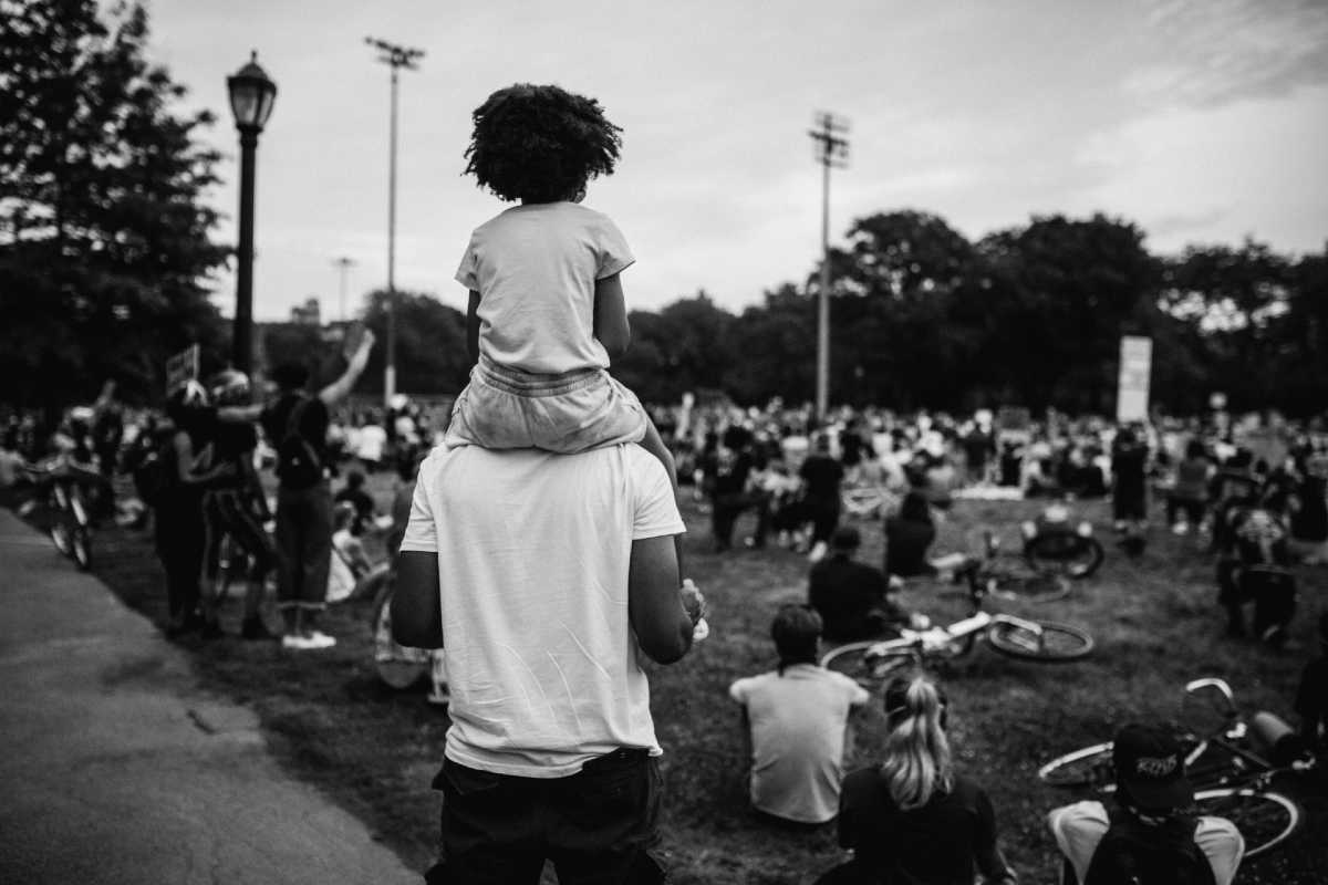 Man with young girl on his shoulders