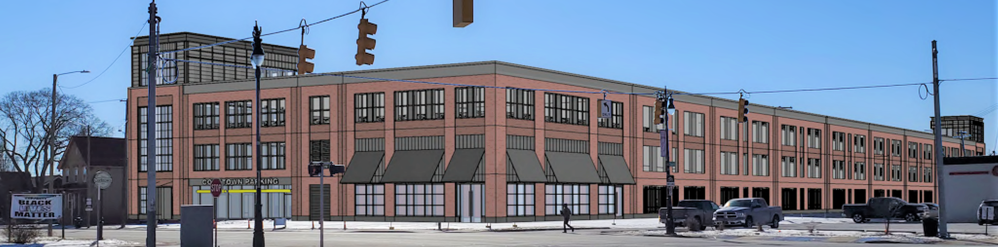 A view from Michigan and Trumbull of the proposed three-story garage in Corktown. The developer has since made changes to the design, including making room to save part of a historic building.