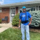 Bernard Cox poses in front of his Eastpointe home